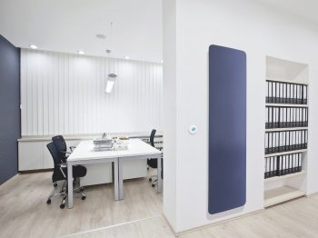 Curva electric radiator providing radiant heat in a modern office